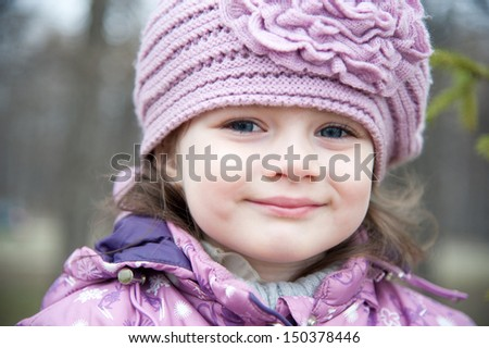 Winter portrait of a beautiful little girl