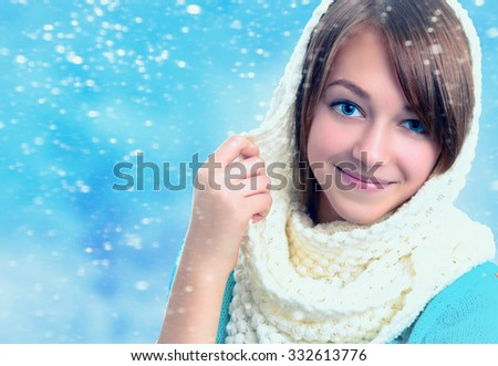 Winter portrait of a beautiful young smiling girl.