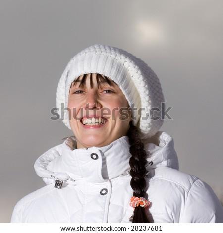 Winter portrait of a happy girl - stock photo