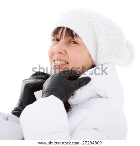 Winter portrait of a happy girl in white dressing - isolated on white - Shallow DOF - stock photo