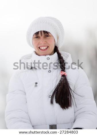 Winter portrait of a happy girl - Shallow DOF - stock photo