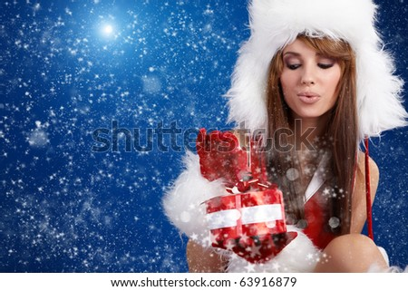 winter portrait of a santa  woman with a christmas gift