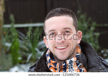 winter portrait of a smiling man - stock photo