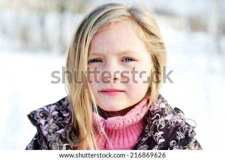 Winter portrait of adorable child girl with dark blond hair  - stock photo