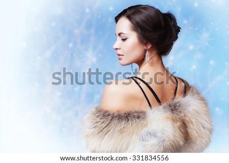 Winter portrait of beautiful fashionable woman in a fur coat. - stock photo
