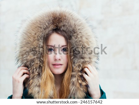 Winter portrait of beautiful girl close-up - stock photo