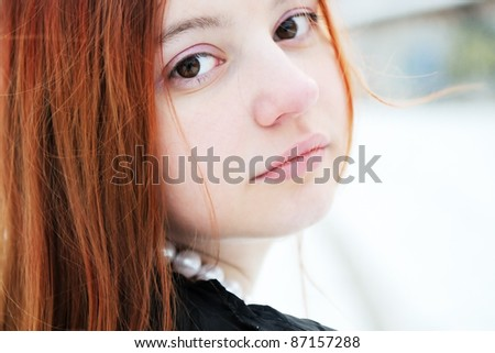 Winter portrait of beautiful girl with big brown eyes - stock photo