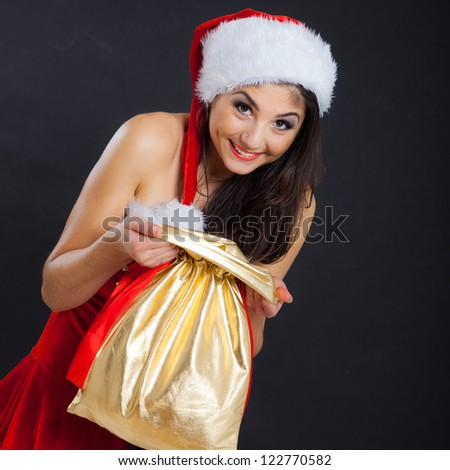 Winter portrait of beautiful sexy girl wearing santa claus clothes - stock photo