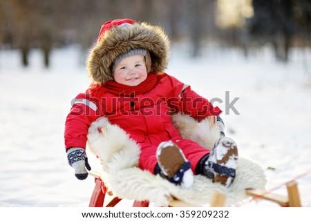 Winter portrait of beautiful toddler boy - stock photo