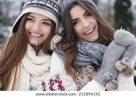 Winter portrait of fashion female friends - stock photo