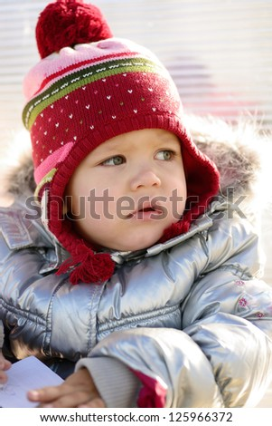 winter portrait of little toddler girl - stock photo