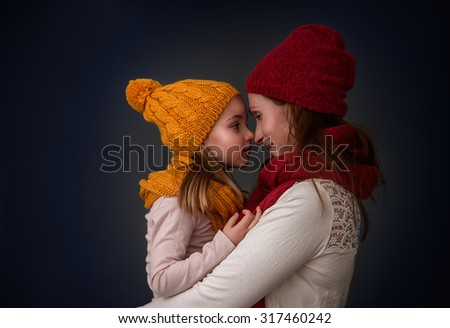 winter portrait of mother with child - stock photo