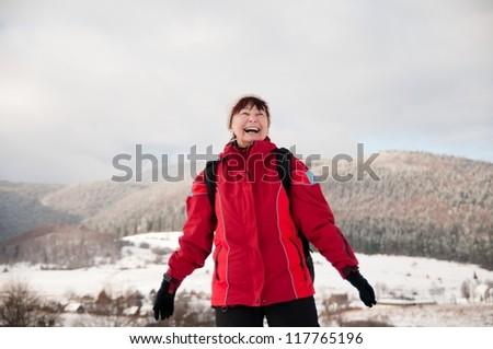 Winter portrait of senior mature in mountain snowy land - stock photo