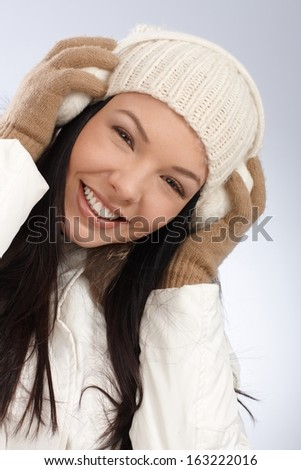 Winter portrait of young attractive smiling woman dressed warm. - stock photo