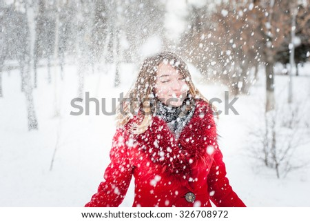 Winter portrait of young beautiful girl with snow. - stock photo