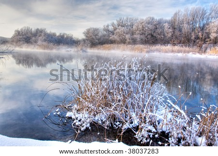 Winter river with pure reflection - stock photo