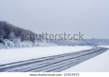 Winter road in distant Russia on which much dangerously go - stock photo