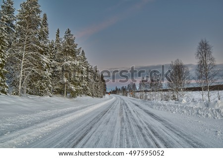Winter Road in Finland in soft warm midday polar light