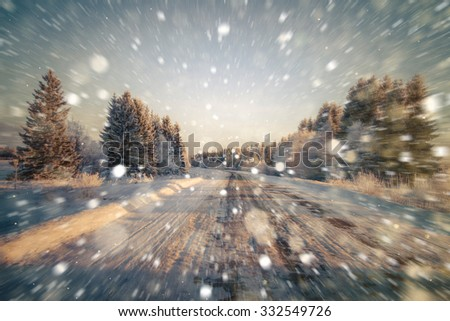 Winter road, sweeping the road, motion blur. Rain, snow, snow turns on the road. Winter background. Copy space. - stock photo