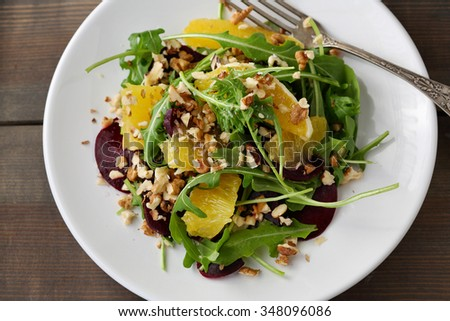 winter salad with orange and beetroots, top view - stock photo
