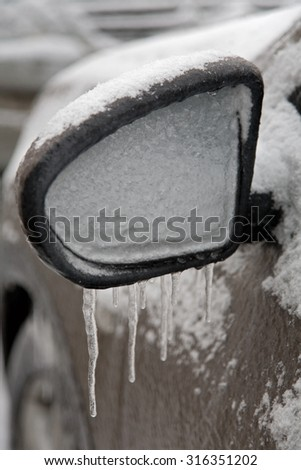 Winter scene -Frost Wrapped  car. icy frozen car on parking - stock photo