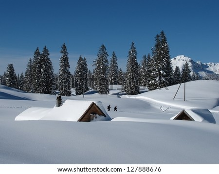 Winter scene in Toggenburg, huts and trees, snow