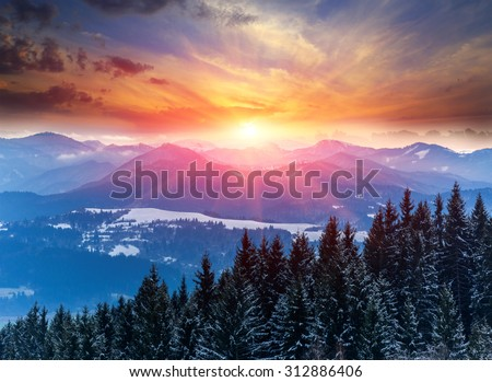 Winter scene with sunset in mountains - stock photo