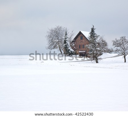 winter scenery with a house - stock photo