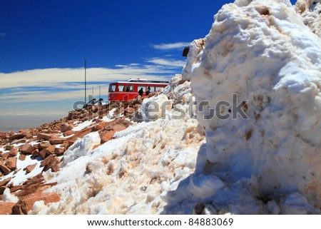 Winter scenery with piles of snow and a train on the top of Pikes Peak Mountain, Colorado, USA - stock photo