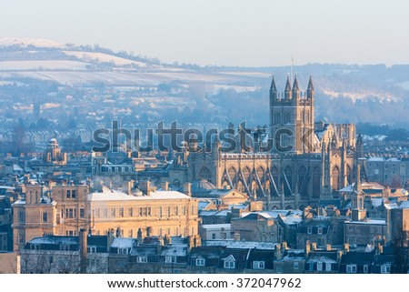 Winter scenic showing Bath Abbey surrounded by Georgian architecture and countryside in Bath, England, UK.