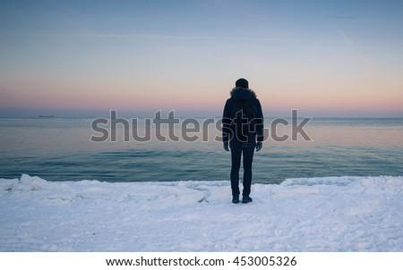 Winter sea and amazing sundown - stock photo