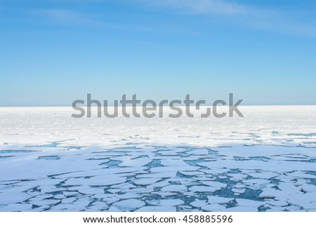 Winter Sea coastal landscape with big floating ice fragment on still cold water, Japan - stock photo