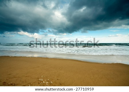 Winter sea with cloudy sky and waves