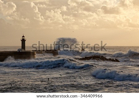 Winter seascape with rough sea and cloudy sky at sunset. North of Portugal. - stock photo