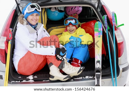 Winter, ski, journey - family with ski equipment ready for travel to ski resort - stock photo