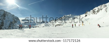 Winter ski panorama in the Alps. Skiers and slopes in S�¶lden, Austria - stock photo