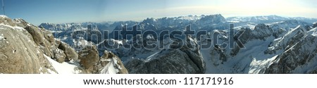 Winter ski panorama in the Alps. Skiers and slopes in Tirol, Italy. - stock photo