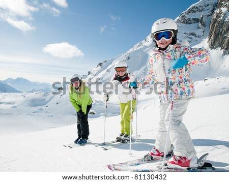 Winter, ski sun and fun - family in ski resort - stock photo