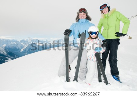 Winter, ski sun and fun - family in ski resort (copy space)
