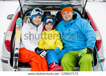 Winter, skiing,  journey - family with ski equipment ready for  travel to ski resort - stock photo