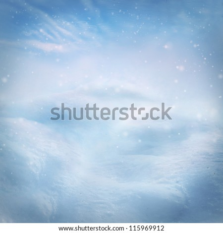 Winter snow background. Snow on the hills with blue sky in the back. - stock photo