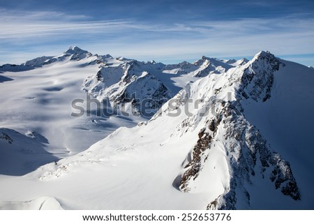 Winter snow covered Alps mountain peaks in Europe.