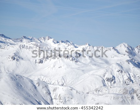 Winter snow covered mountain peaks in Europe. Great place for sports - stock photo