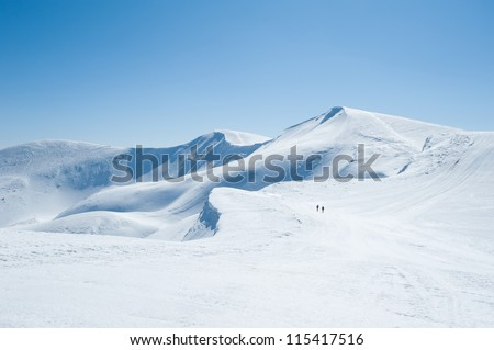 Winter snow covered mountain peaks in Europe. Great place for winter sports - stock photo