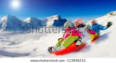 Winter, snow, family sledding at winter time - stock photo