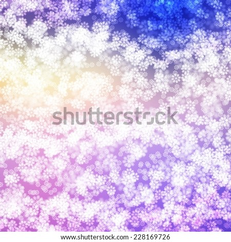 Winter Snow Sparkling Bokeh Light Effect Background with Blue, Purple, Yellow and White Blurry Snowflakes - stock photo