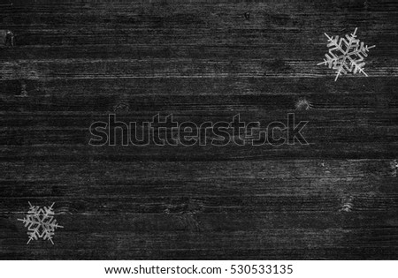 Winter Snowflakes On Rustic Black Wood Background