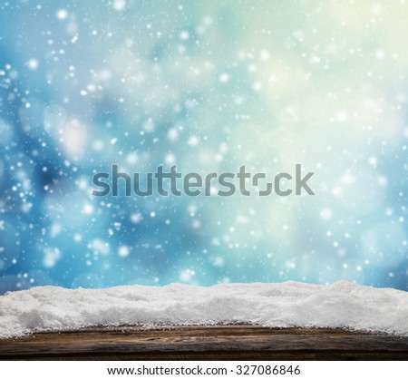 Winter snowy abstract background with pile of snow on wood - stock photo