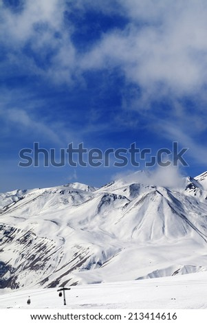 Winter snowy mountains and ski slope. Caucasus Mountains, Georgia. Ski resort, Gudauri.