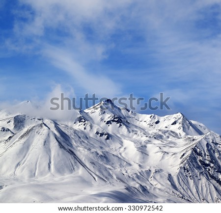 Winter snowy mountains in windy day. Caucasus Mountains, Georgia, Gudauri. View from ski resort. - stock photo